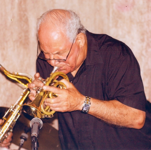 Lou Colombo playing a pocket trumpet at the Roadhouse Cafe Florida.